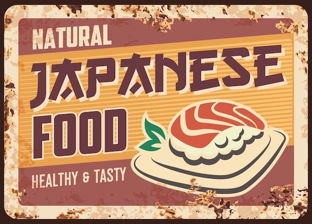 Placa de metal enferrujada de comida japonesa com sushi nigiri.