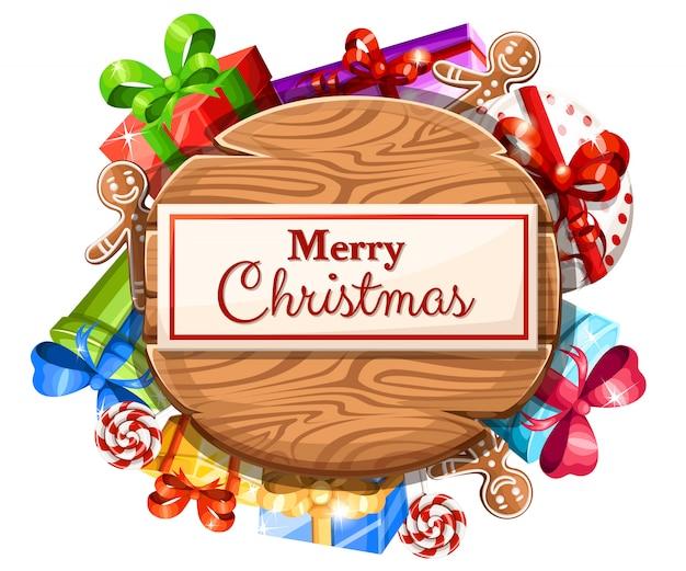 Placa de natal de madeira com conjunto de presentes e a inscrição com ilustração de feliz natal em fundo branco.