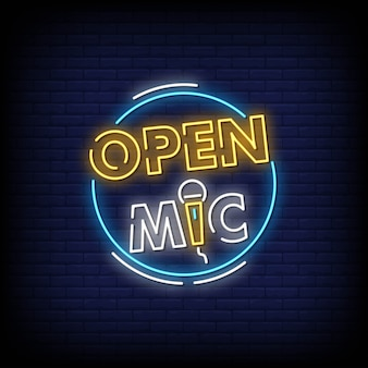 Placa de néon de microfone aberto na parede de tijolo