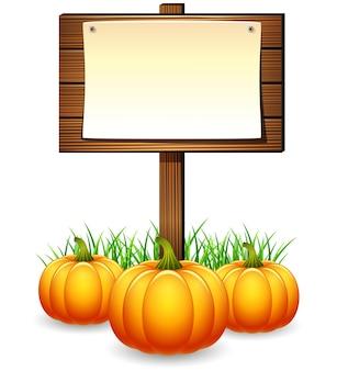 Placa de sinal de madeira com abóboras