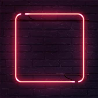 Placa quadrada de néon rosa na parede de tijolos
