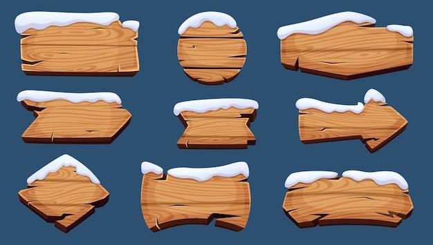 Placas de inverno. banners de temporada de madeira com cobertura de neve