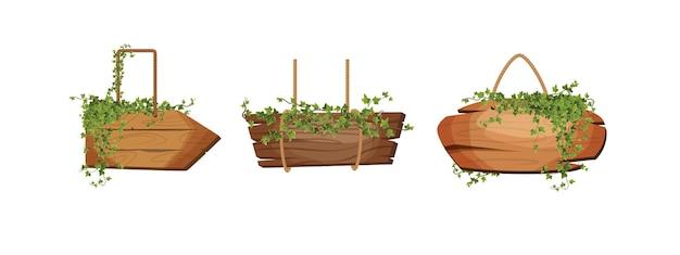 Placas de madeira vazias penduradas com cordas e folhas de hera como faixas para jogos