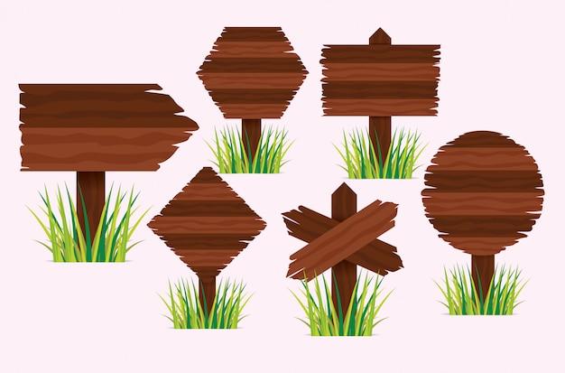 Placas de sinal de madeira com grama