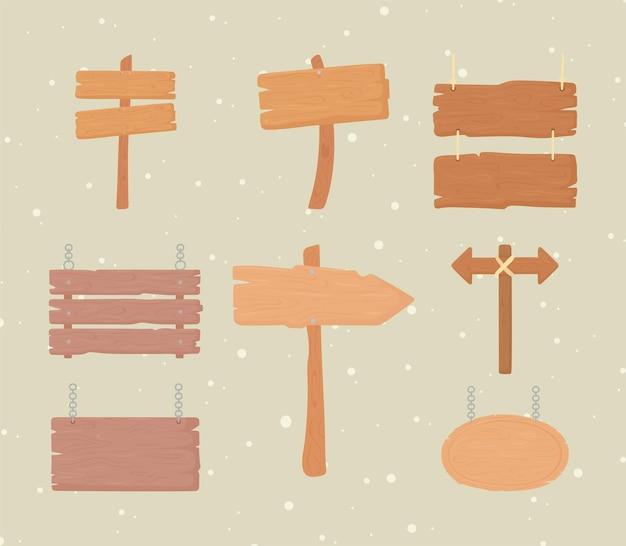 Placas de sinalização de madeira e setas