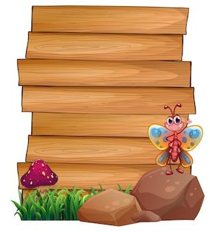 Placas vazias com uma borboleta acima de uma rocha