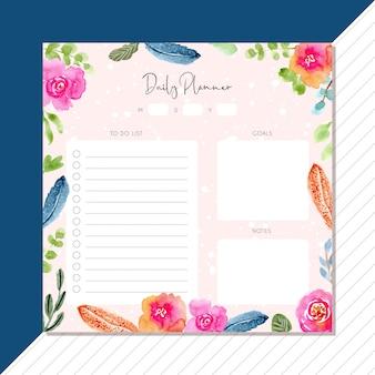 Planejador diário com penas de aquarela e moldura floral