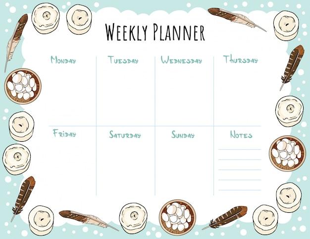 Planejador semanal aconchegante boho e para fazer a lista com velas, penas e ornamento de seixo. bonito modelo para agenda, planejadores, listas de verificação.