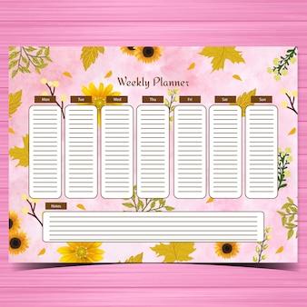 Planejador semanal de estudante com lindas flores amarelas e fundo rosa abstrato