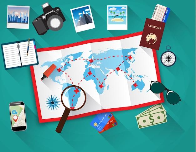 Planejando o conceito de viagem à mesa com o mapa do mundo em papel,