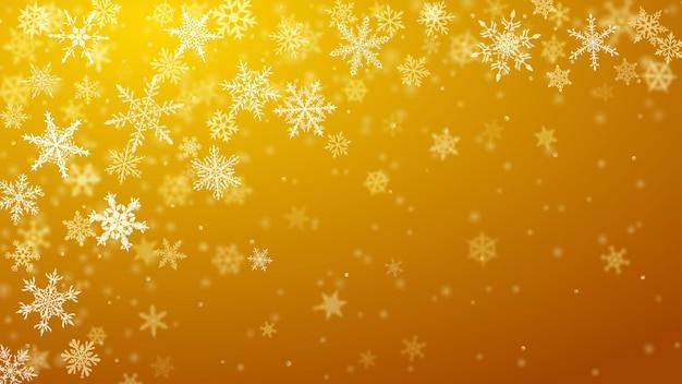 Plano de fundo de natal de complexos flocos de neve caindo e turvos em cores amarelas com efeito bokeh