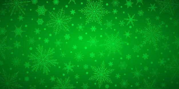 Plano de fundo de natal de vários flocos de neve grandes e pequenos complexos, em cores verdes