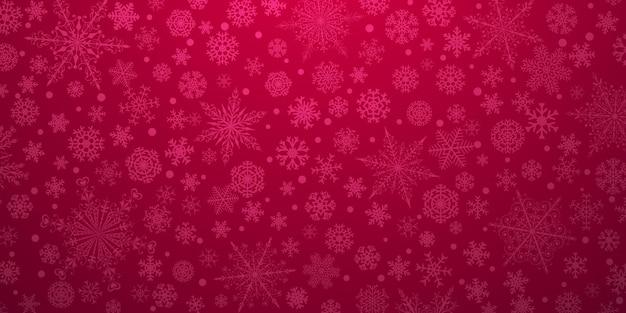 Plano de fundo de natal de vários flocos de neve grandes e pequenos complexos, em cores vermelhas