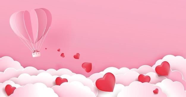 Plano de fundo dia dos namorados com balão de ar quente voando o coração flutuando na nuvem