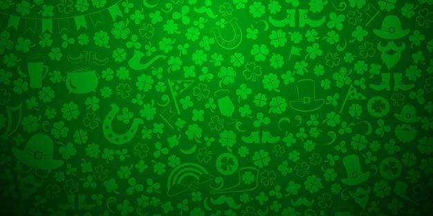 Plano de fundo do dia de são patrício feito de folhas de trevo e outros símbolos em cores verdes