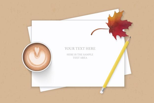 Plano leigo vista superior elegante composição branca papel amarelo lápis outono folha de plátano e café em fundo kraft.