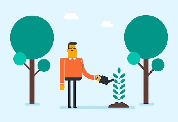 Planta molhando do jardineiro branco caucasiano novo.