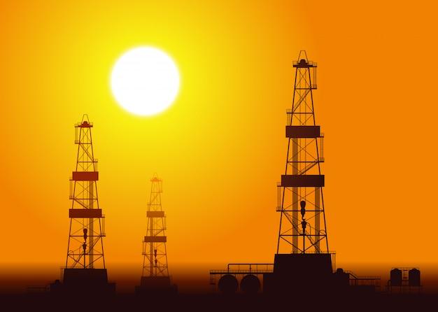 Plataformas petrolíferas sobre o por do sol.