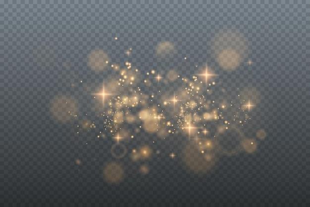 Pó de ouro cintilante com estrelas de ouro cintilantes em um fundo transparente