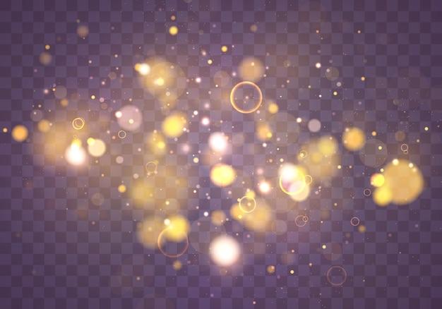 Pó mágico cintilante e partículas douradas em fundo transparente. brilhante e elegante. conceito mágico. efeito bokeh abstrato.