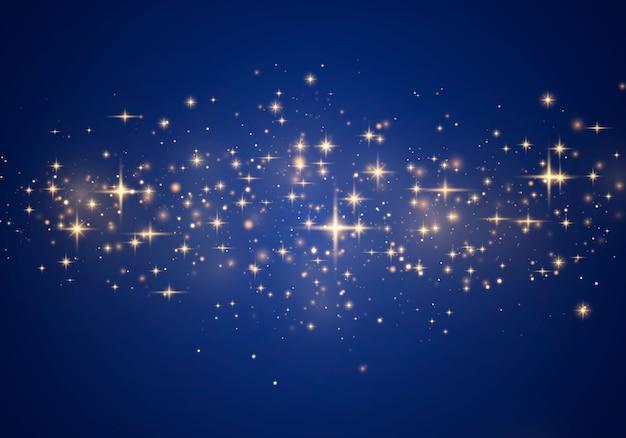 Pó mágico cintilante e partículas douradas sobre fundo azul.