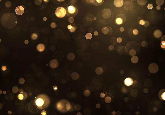 Pó mágico cintilante e partículas douradas sobre fundo preto.