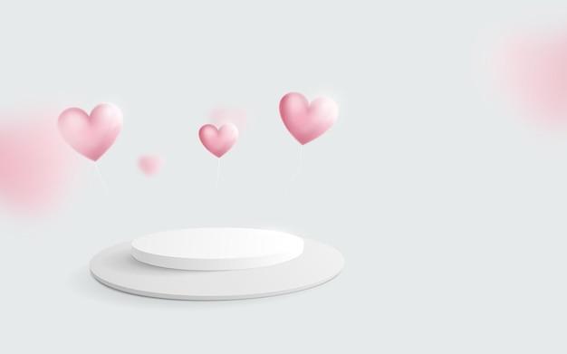 Pódio branco com balões de coração flutuando.