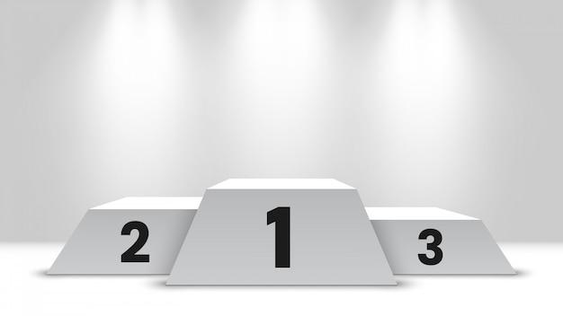 Pódio de vencedores branco com holofotes. pedestal.