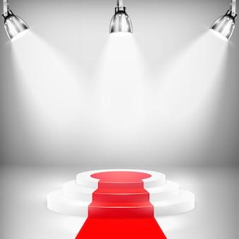Pódio iluminado com tapete vermelho