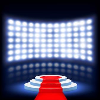 Pódio iluminado para cerimônia com tapete vermelho