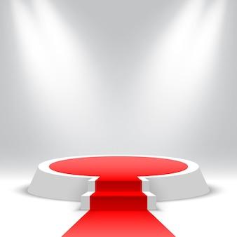 Pódio redondo branco com tapete vermelho e escadas pedestal em branco com degraus e holofotes