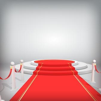 Pódio redondo com tapete vermelho e barreiras