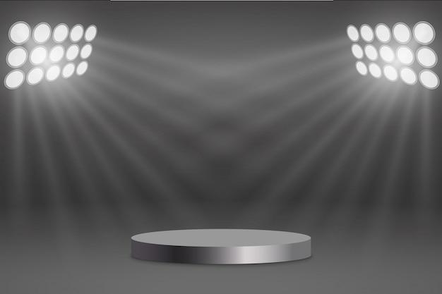 Pódio redondo iluminado por holofotes