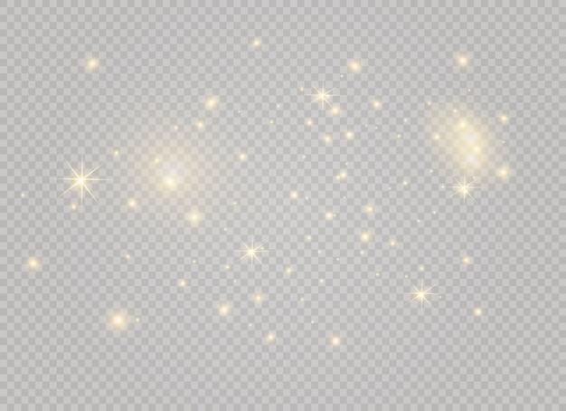 Poeira branca. faíscas brancas e estrelas douradas brilham com luz especial. brilha em um fundo transparente. partículas de poeira mágica cintilante.