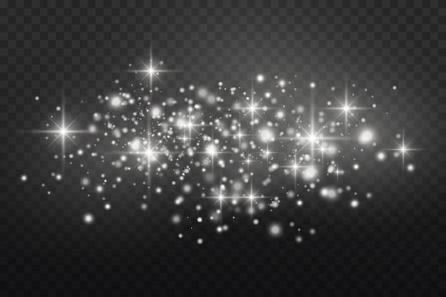 Poeira branca. faíscas brancas e estrelas douradas brilham com luz especial. brilha em um fundo transparente.