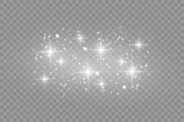 Poeira branca. faíscas brancas e estrelas douradas brilham com uma luz especial. o vetor brilha em um fundo transparente. padrão abstrato de natal. Vetor Premium