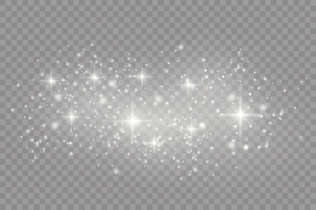 Poeira branca. faíscas brancas e estrelas douradas brilham com uma luz especial. o vetor brilha em um fundo transparente. padrão abstrato de natal.