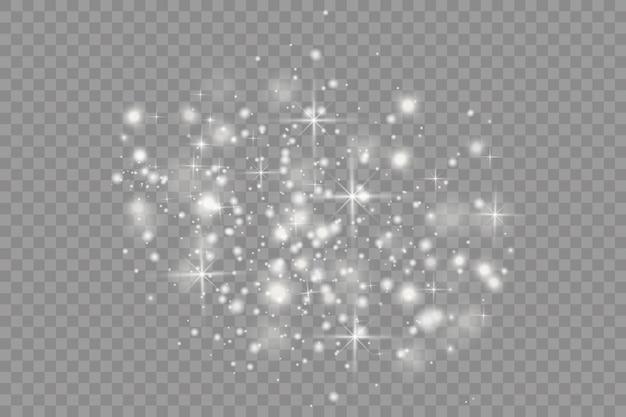 Poeira branca. faíscas brancas e estrelas douradas brilham com uma luz especial.