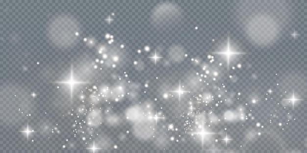 Poeira cintilante de luz de natal com estrelas cintilantes em uma textura cintilante de fundo transparente