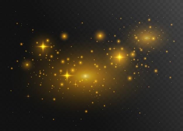 Poeira de ouro. faíscas brancas e estrelas douradas brilham com luz especial.