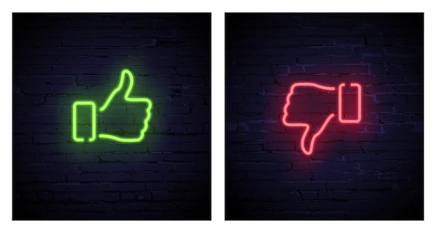 Polegar verde para cima e polegar vermelho para baixo símbolos de néon isolados em fundo de tijolo escuro