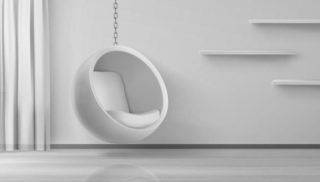 Poltrona redonda pendurada em corrente no interior da casa