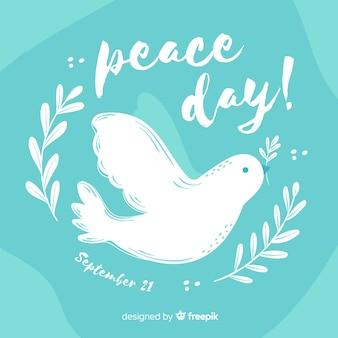 Pomba para a mão do dia da paz desenhada