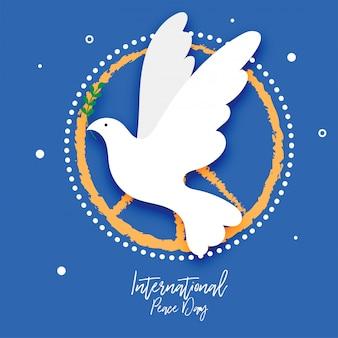 Pombo com o símbolo da folha da paz. dia internacional da paz