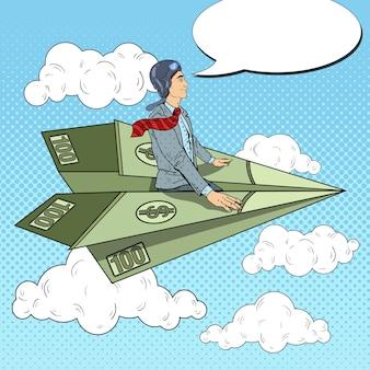 Pop art empresário de sucesso voando em um avião de papel do dólar.