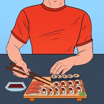 Pop art homem comendo sushi no restaurante asiático. comida japonesa.