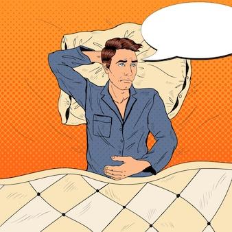 Pop art homem na cama, sofrendo de insônia e insônia