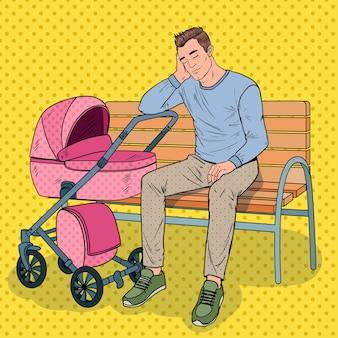 Pop art insone jovem pai sentado no banco do parque com o carrinho de bebê. conceito de paternidade. homem cansado com filho recém-nascido.
