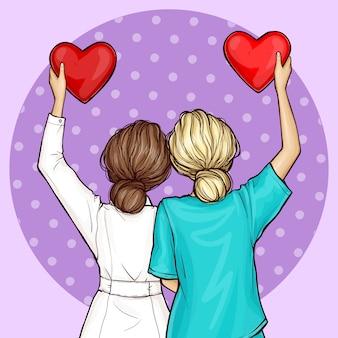 Pop art médico e enfermeira segurando corações vermelhos