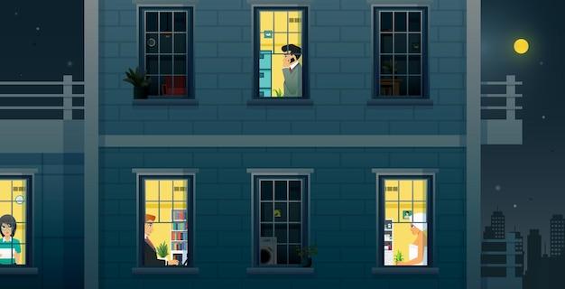 População masculina e feminina trabalhando em casa à noite.